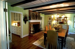 Outside of some painting and decorations, the dining room with the wooden beams and ceiling remains close to the original in the home of Wyatt and Dianne Clark. Jon C. Lakey/Salisbury Post