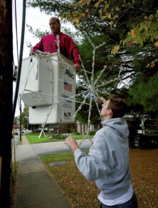 JON C. LAKEY / SALISBURY POST  Bill Fraley (in bucket) and Joseph Peeler, from Chapman Signs, use a bucket truck to put up the annual Christmas  decorations of  snowflakes in advance of the upcoming holidays.