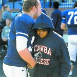 Catawba College football player Steven Barlett came over to Robert Gilmore at the start of the game and gave him a handshake and hug. A Salisbury High School senior battling cancer for the third time in his life, was an honorary coach for the Indians' game against Lenoir-Rhyne on Saturday and provided inspiration for the team in its victory. Wayne Hinshaw/For the Salisbury Post