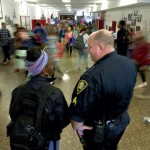 A student stops to talk with Deputy C.S. Flowers in the busy East Rowan High School hallway. Jon C. Lakey/Salisbury Post