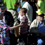 Andrew Padgett, 8, comes to see the veterans waiting on the parade at the N.C. State Veterans Home on the VA Medical Center campus. Jon C. Lakey/Salisbury Post
