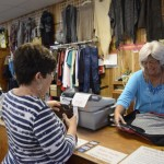 Lyndall Campbell, a breast cancer survivor, helps a customer at Quality Clothing in China Grove. Rebecca Rider/Salisbury Post