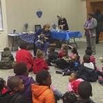 Lea Silverburg talks with children about Hanukkah.