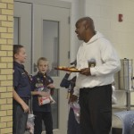 "Michael Thigpen talks with Cub Scouts Jackson Walters and Lachlan Jackling, who were with Pack 524 distributing ""Blessing Bags"" to Rowan Helping Ministries guests. Thigpen who stayed at the shelter nearly three years ago marveled at the kindness of the Scouts. Shavonne Walker/Salisbury Post"