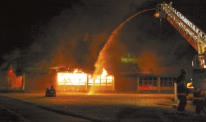 Salisbury Post File Photo On the night of Dec. 30, 2014, flames engulfed the Dunbar Center in East Spencer. Here firefighters spray water on the building as fire rages inside.