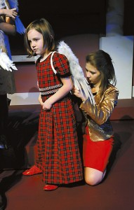 The Best Christmas Pageant Ever: Emery Franz getting her angel wings adjusted by  Sarah Hallett     Photo by Wayne Hinshaw, for the Salisbury Post