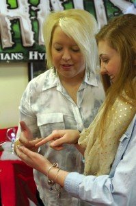 Candice Carter, who leads CHAOS, looks over an ornament with Rebecca Clark.