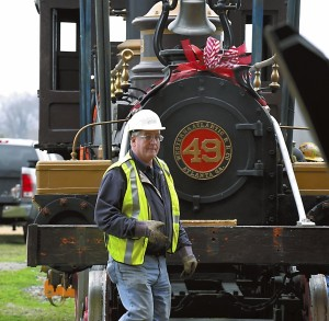 """The 1856 locomotive """"Texas"""" and 1880's tender arrived at the N.C. Transportation Museum by truck to be renovated at the Museum by """"Steam Operations Corporation."""" The locomotive was lifted by crane from the truck and set on tracks. Scott Lindsay, president of """"Steam Operations Corporation"""" checks the engine. photo by Wayne Hinshaw, for the Salisbury Post"""
