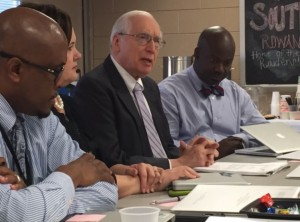 Dr. Gene Bottoms visits with local principals.