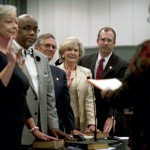 Salisbury City Clerk Myra Heard, right, administers the oath of office to City Council members, from left, Maggie Blackwell, Kenny Hardin, David Post, Karen Alexander and Brian Miller at Tuesday's meeting. Jon C. Lakey/Salisbury Post