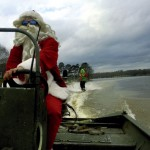 As seen in this photo submitted by Chipper Thomas, water temperatures near 68 degrees on High Rock Lake on Christmas Day prompted Scott Thomas and Seth Thomas to put on a show. Scott Thomas, dressed as a Santa Claus, drove a boat while pulling Shawn dressed as a grinch near Bringle Ferry Road.