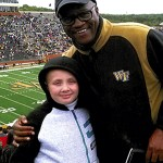 Mt. Sinai Baptist Church of Catawba Pastor Donald Gray, right, took kids like London Murrell to the football game between Wake Forest University and Duke University on Saturday to broaden their horizons. Submitted photo