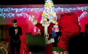 JON C. LAKEY / SALISBURY POST Santa Claus wishes everyone a Merry Christmas. The Christmas spirit is alive and well along the tracks at the North Carolina Transportation Museum for the The Polar Express Train Ride.  Monday, December 21, 2015, in Spencer, N.C.
