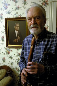 In a photo from 2006,  an 81-year-old Dale Higbee stands next to a portrait of a younger Dale Higbee hanging in the front entrance hall of his Ellis Street home. Jon C. Lakey/Salisbury Post