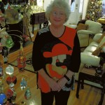 Joy Hamilton stands amid some of the Christmas decorations in her living room. She always keeps up her Christmas decorations through Jan. 15, her birthday.