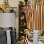 Clark adds two different lampshades to milk glass lamps at Salisbury Square Antiques to create two different looks. Susan Shinn/For the Salisbury Post