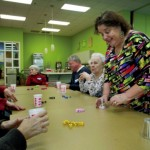 Brenda Zimmerman, director of life enrichment at Trinity Oaks health and rehab, plays games with residents in the Activity room at the facility.  Jon C. Lakey/Salisbury Post