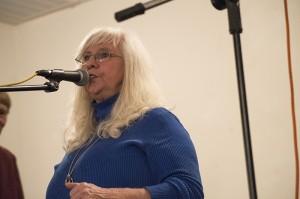 Josh Bergeron / Salisbury Post - State Bluegrass Association President Vivian Hopkins speaks Saturday during a benefit event for Bob Shue.