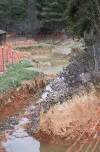 Josh Bergeron / Salisbury Post - Nine months after a tanker truck overturned on Bringle Ferry Road, a large ravine now mars the yard of a house owned by Rowan resident Sheila Shepherd, who is a plaintiff in a lawsuit about the spill's effects.
