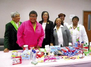 Elizabeth Sippel and members collect donations for Care Kits.