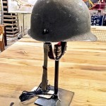 Old military helmet used as a shade on this one-of-a-kind lamp by Blue Ocean Traders. (Patricia Sheridan/Pittsburgh Post-Gazette/TNS)