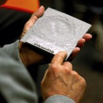 Vance Eller uses his hands to 'see' the details in three-dimensional rendering of a crater located on the Earth's moon. Jon C. Lakey/Salisbury Post
