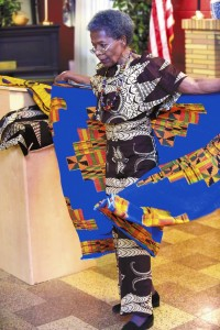 Thomasina Page demonstrates how a traditional African dress is wrapped around the ladies body at the African American Fashion Show  fundraiser for the Spencer Doll and Toy Museum.  photo by Wayne Hinshaw, for the Salisbury Post