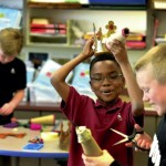 Cannon School fourth-grader A.J. Amani tries out the crown he made out from recycled materials. Jon C. Lakey/Salisbury Post