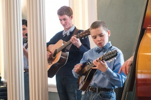 Josh Bergeron / Salisbury Post - James Lee, an 11-year-old member of Back Creek Bluegrass Boys, plays a tune Sunday during a practice session at Rowan Museum.