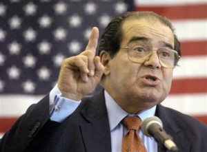 In 2004 file photo, U.S. Supreme Court Justice Antonin Scalia speaks to Presbyterian Christian High School students in Hattiesburg, Miss.  AP photo