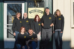 Josh Bergeron / Salisbury Post - Founders and board members of nonprofit The Pedal Factory pose for a picture Friday in front of their store on South Main Street.