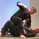 Ricky Smith, on bottom, shows how to get away from his attacker, Lukas Miller. Photo by April Everett.