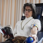 Marianna Swaim reads as she waits to donate blood at Alex Yate's birthday blooddrive. Rebecca Rider/Salisbury Post
