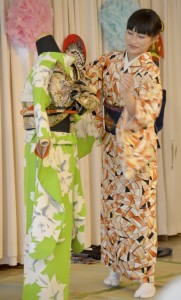 Yoshiko Kikuchi demonstrates how to put on a kimono at the Spencer Doll and Toy Museum's Doll Day exhibit. Kikuchi gave the history of the kimono and explained the time and precision it took to put on the Japanese garment. Shavonne Walker/Salisbury Post