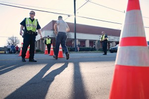 ALLISON LEE ISLEY/SALISBURY POST Police Officers direct traffic so Rowan County citizens can cross the street to wait in line and cast their votes at the Granite Quarry Municipal Building in Salisbury on Tuesday, March 15, 2016.