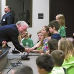 School board member Chuck Hughes shakes hands with students who came to the ribbon cutting. Jon C. Lakey/Salisbury Post