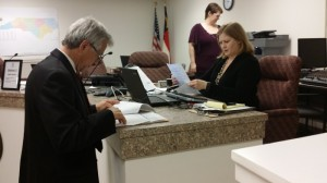 Submitted photo - State Rep. Harry Warren on Tuesday fills out paperwork to run for Congress.