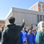 UNCC student Colton Opel tells Knox Middle seventh graders about the Atkins Library during the group's campus tour. Rebecca Rider/Salisbury Post
