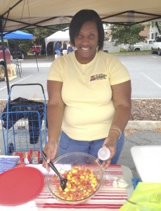 Cooperative Extension Agent Toi Degree does a cooking demonstration at the 2015 Farmers' Market.