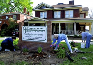 A group of FUMC women, including (left to right) Nancy Sherriff, Sara Hill, and Nancy Schoch, did landscaping at Capstone Recovery Center, part of a Day of Service initiative organized by First Methodist.