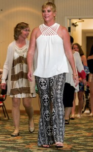Mary Willis Page, 3 1/2 year ovarian and uterine cancer survivor, models in the Survivor Fashion Show.  Allison Lee Isley/Salisbury Post