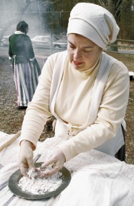 Kaye Brown Hirst makes rivels of flour and egg for a pot of potato soup during the German Christmas Celebration at the Old Stone House in 2000.