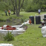 Absorbent pads and absorbent booms are used to catch the kerosene that spilled into the creek at Hurley Park. Shavonne Walker/Salisbury Post