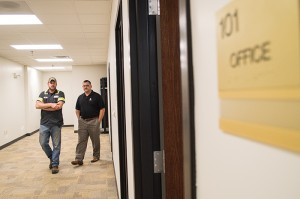 Josh Bergeron / Salisbury Post - Rowan County Manager Aaron Church (at right) tours office space for Veterans Services at the West End Plaza. Veterans Services is scheduled to move to the West End Plaza in June or July and the Board of Elections are scheduled to move to West End Plaza this month.