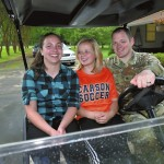 Franzisca Botur, 17, Elora Suggs, 15, and Alan Suggs take in the family's 'Keep Pounding Carolina Panthers' golf cart. Wayne Hinshaw/For the Salisbury Post
