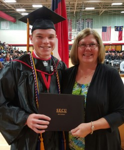 """Andrew Eller, left, a senior at South Rowan High School, was awarded the State Employee Credit Union Foundation's """"People Helping People"""" scholarship. Submitted photo"""