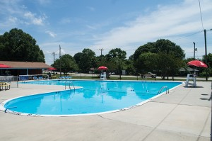 Josh Bergeron / Salisbury Post - A crowd of community members and city staff gathered at the newly renamed Fred M. Evans Pool on Saturday for a ceremony to honor the late Fred Evans.