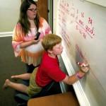 Kristie Wooten watches as her son Noah diagrams a compound sentence on the dry erase board. Jon C. Lakey/Salisbury Post