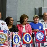 Veterans line up to display the quilts given to them during the Sunny Days and Starry Nights 2016 Quilt Show. Allison Lee Isley/Salisbury Post