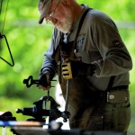 Jim Sabo adds a twist to a hook he is working on in his mobile blacksmith shop at the Simple Living festival on Saturday. A science teacher at East Rowan High School, Sabo said he plans to blacksmith and attend shows full time once he retires. Jon C. Lakey/Salisbury Post